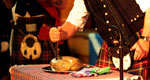 Cutting the haggis with a sgian dubh.
